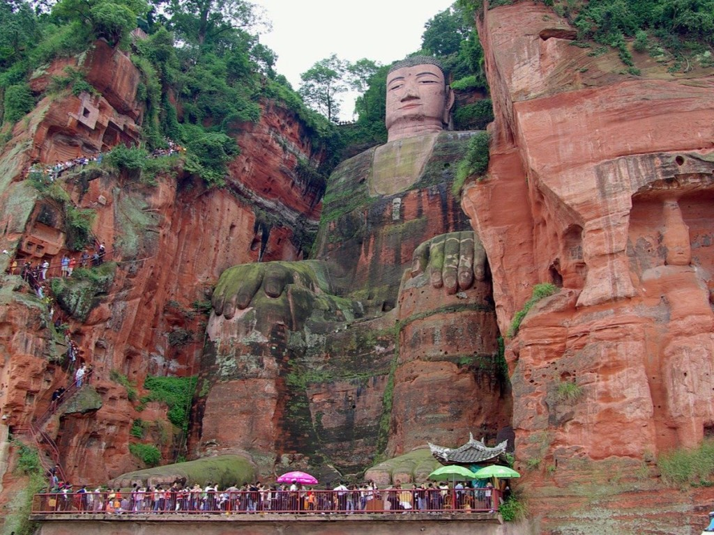 the-232-foot-high-leshan-giant-buddha-carved-on-the-hillside-of-the-xijuo-peak-overlooks-three-of-chinas-rivers-the-unesco-world-heritage-site-is-built-with-incredible-detail-over-a-thousand-buns-w