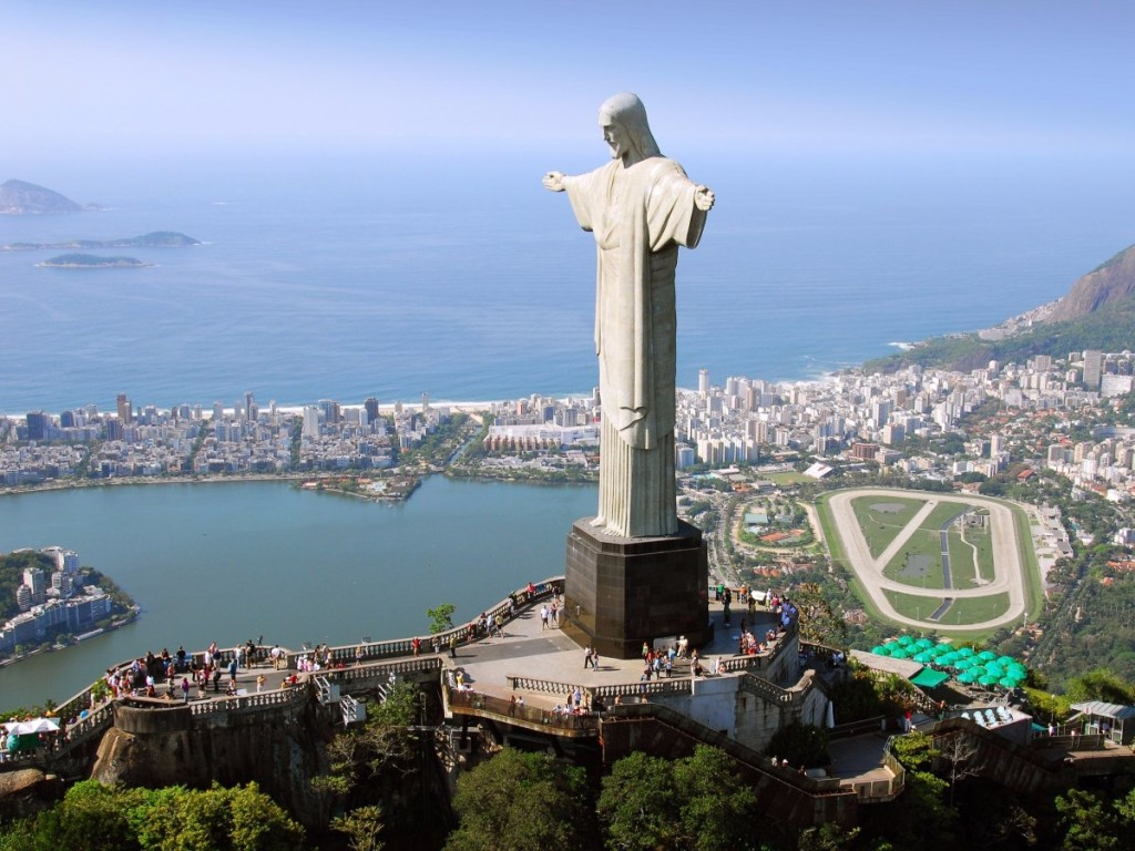 the-christ-the-redeemer-statue-located-in-rio-de-janeiro-brazil-scales-more-than-2000-feet-above-the-city-to-offer-visitors-stunning-views-the-100-foot-tall-statues-awe-inspiring-scale-and-design-r