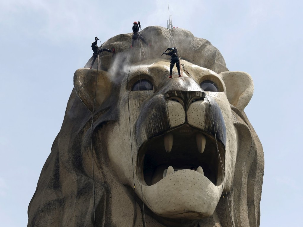 the-merlion-of-sentosa-standing-on-singapores-sentosa-island-is-a-121-foot-sculpture-of-a-mythical-lion-headed-fish-of-the-same-name-a-national-emblem-its-name-was-derived-from-a-malay-word-meaning