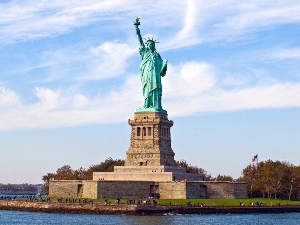 the-statue-of-liberty-stands-high-and-mighty-in-new-york-harbors-liberty-island-the-305-foot-statue-from-ground-level-to-flame-tip-was-created-in-france-with-giant-steel-supports-before-being-assem