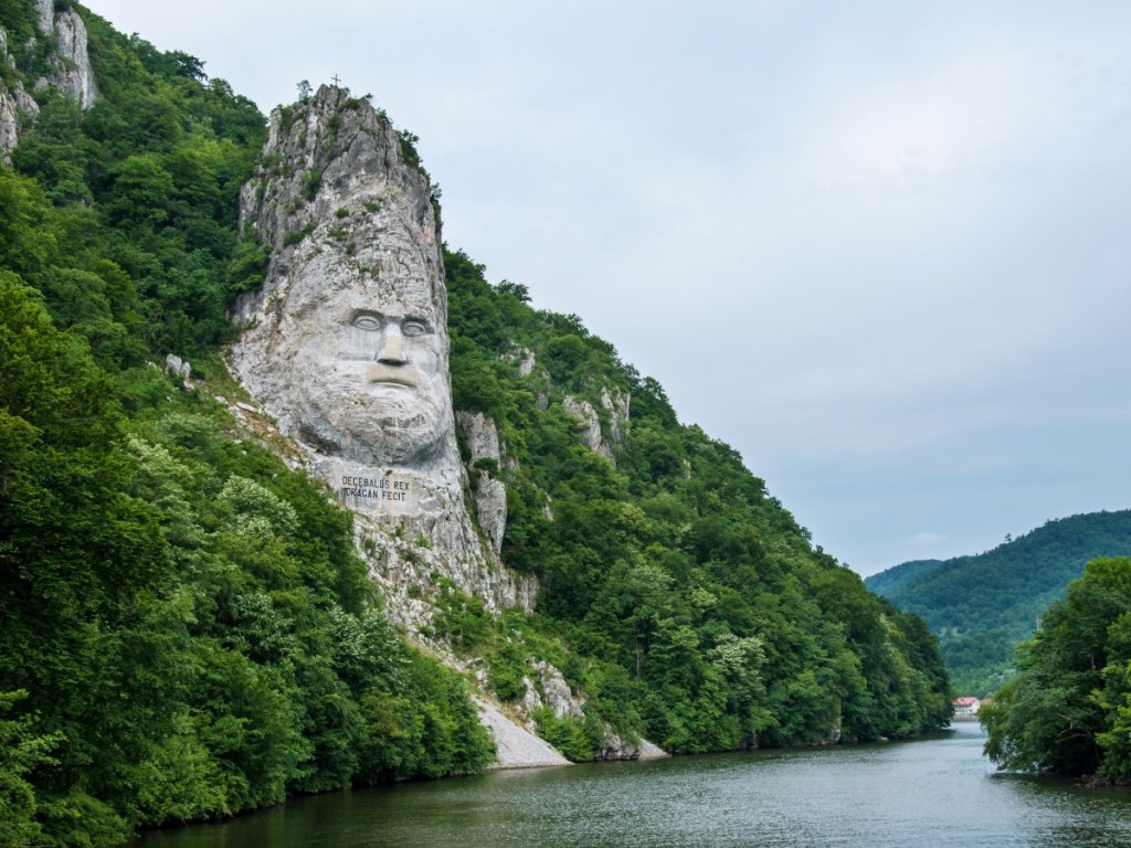 this-rock-sculpture-of-the-face-of-decebalus-dacias-last-king-is-carved-on-a-jagged-outcrop-of-the-danube-river-near-the-city-of-orsova-in-romania-the-131-foot-high-carving-is-the-tallest-rock-scul
